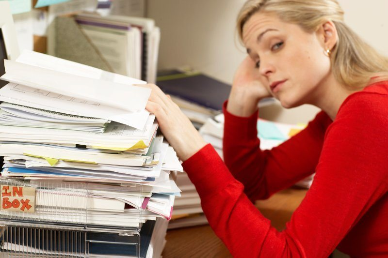 Woman sorting through paperwork