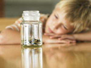 Child with money in jar