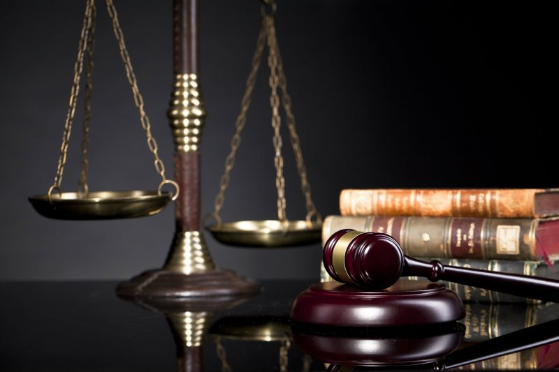Gavel, scale, and law books