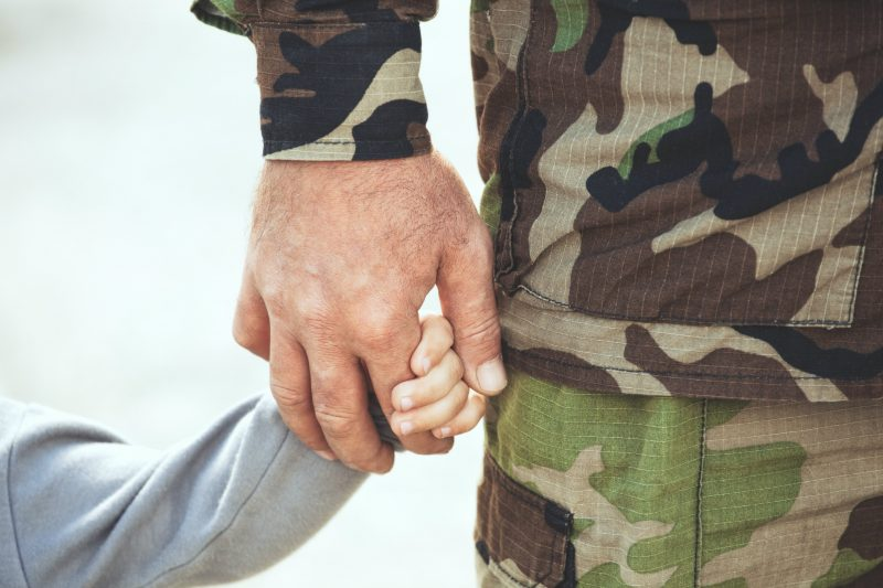 Soldier holding hand