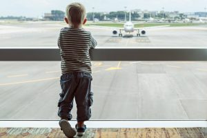 Child looking at airplane