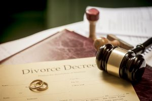 Divorce decree with rings and gavel