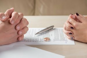 Spouses sitting with divorce documents