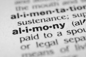 Photo of alimony definition written on paper