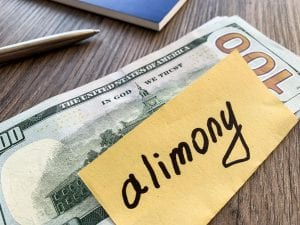 Alimony envelope with 100 dollar bill