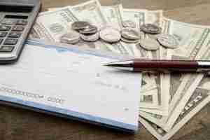 Checkbook with money