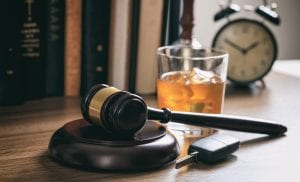 Law gavel with alcohol
