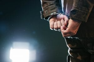 Man handcuffed at night