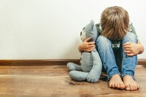 Sad child with bear
